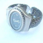 Multi pin clock face with daisy flower on band bangle watch