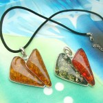 Double small triangle faux amber pendant Black or brown necklace cord included