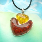Double heart faux amber pendant Black or brown necklace cord included