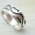 Fine 925. sterling silver ring with tribal etch-in design