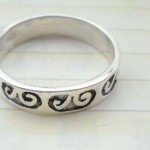 925. stamped silver ring with a pair spiral design