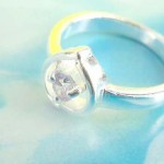 Little water-drop holding a clear rhinestone, precious 925. sterling silver ring