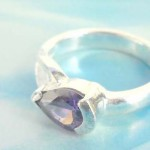 Outstanding 925. stamped silver ring with amethyst falling drop