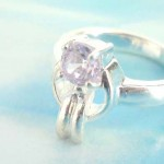 Outstanding 925. stamped silver ring with carrot holding a purple cz
