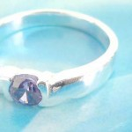 Favorite 925. stamped silver ring holding amethyst rhinestone