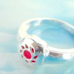 Silver flower with red cz design,vintage 925. stamped silver ring