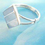 Collectible stamped 925 sterling silver diamond ring with blue seashell design