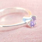 925. stamped silver ring with a round purple cubic zirconia design