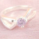 Collectible stamped 925 sterling silver purple rhinestone with bow tie shape ring