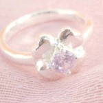 Favorite 925. stamped silver ring motif silver flower with purple cubic zirconia inlay