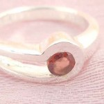 Favorite 925. stamped silver ring motif a clip holding ruby cz design