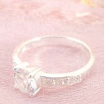 925. stamped silver ring with enlarge clear cz and decor on band design