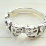 Unique 925 sterling silver ring with 5 dolphin forming a line design