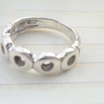 Plain stamped 925 sterling silver ring with multi O shape design
