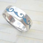 Plain stamped 925 sterling silver ring with blue color wavy design