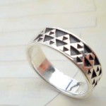 Stamped 925. silver ring with multi triangle wrap around band ring design