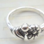 Quality 925. stamped silver flower ring