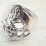 Favorite 925. stamped silver ring motif skull and snake on forehead design