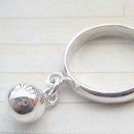 Outstanding 925. stamped silver ring with jingle bell design