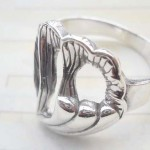 Outstanding 925. stamped silver ring with filigree heart design
