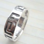 Outstanding 925. stamped silver ring with puzzle design