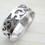 Collectible stamped 925 sterling silver ring with graved multi angle design