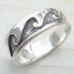 Collectible stamped 925 sterling silver ring with graved moutain design
