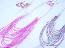 Seed beaded multi string fashion pink and purple jewelry set