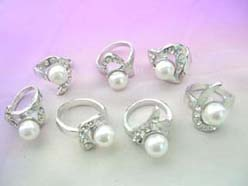 wholesale costume jewelry ring with imitation pearl bead surrounded by cz crystals
