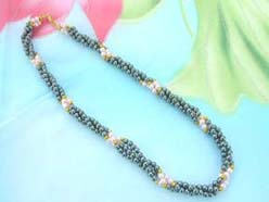triple twisted beaded hematite necklace with gold and imitation pearl beads