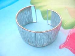 costume jewelry bangle with silver threaded lines