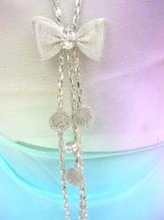 bow tie cz tassel long chain necklace, chain in silver color