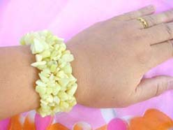 Stretch Bracelet Made Of Yellowish Green Gemstone Chips