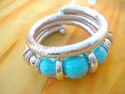 silver coil snake wrapped bangle bracelet with natural turquoise gemstone beads