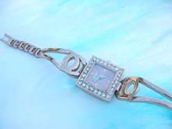 Shiny copper drop shape on band with square cz clock face watch