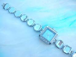 Square clock face with cz inlaid silver bracelet watch