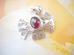 Filigree bird with ruby inlaid, precious 925. sterling silver pendant