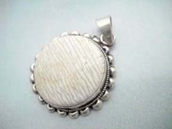 Fine 925. sterling silver sun flower animal bone pendant