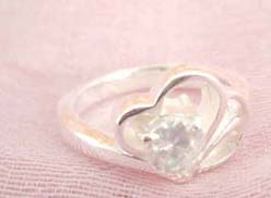Great stamped 925 sterling silver ring with double heart shape holding clear cz flower design