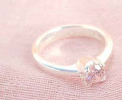 925. stamped silver ring with a round pinky cubic zirconia design