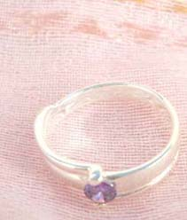 925. stamped silver ring with thick band holding a purple design